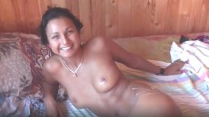 My sexy girl naked on the bed with my sperm on her hip and nipple